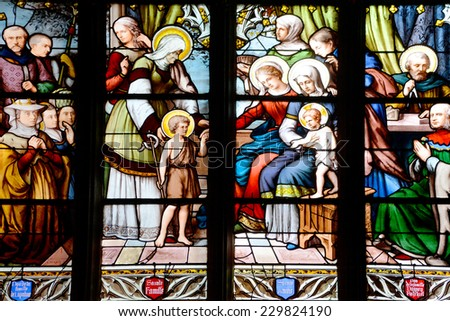 PARIS, FRANCE - OCTOBER 19: Stained glass window in the Church of Saint-Severin  is a Roman Catholic church in the Latin Quarter of Paris, France, on october 19, 2014,  - stock photo