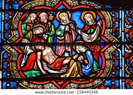 PARIS, FRANCE - OCTOBER 19: Stained glass window in the Notre Dame cathedral of Paris, France, on october 19, 2014, one of the most famous landmarks in Paris.  - stock photo