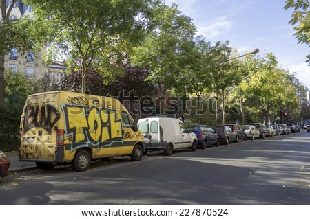 Paris, France - October 31: Street art graffiti on an a car in the city, October 31, 2014 in Paris, France - stock photo