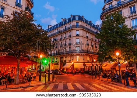 Paris, France - October 17, 2016: street cafes on the Ile Saint Louis in Paris with unidentified people at night. The Ile Saint Louis is one of two natural islands in the Seine river inside of Paris