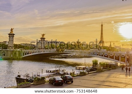 Paris, France - October 06 2017:  sunset magic on the Seine River in Paris in France from the Alexander III Bridge with a view on the Eiffel Tower