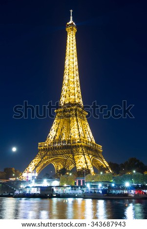 Paris, France-October 26, 2015 : The Eiffel tower is one of the most visited monument in the world located on the bank of Seine river in Paris, France.