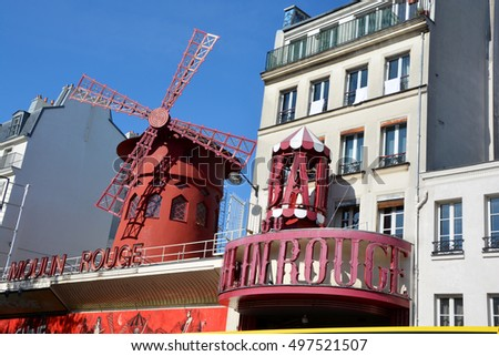 PARIS FRANCE OCTOBER 19, 2014: The Moulin Rouge in Paris, France. Moulin Rouge is a famous cabaret built in 1889, locating in the Paris red-light district of Pigalle.