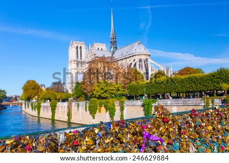PARIS, FRANCE - OCTOBER 14, 2014: View on Notre Dame Cathedral from the bridge Pont de l'Archeveche(bridge of the Diocese). The bridge now is full of Love Lockers. - stock photo