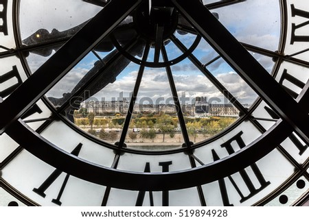 Paris, France - October 19, 2016: view through the giant clock of the Musee dOrsay. It is housed in the former Gare d'Orsay, a Beaux-Arts railway station. It is one of the largest museums in Europe