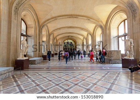 PARIS, FRANCE-OCTOBER 3 : Visitors in painting gallery on October 3, 2012 in Louvre Museum, Paris, France. With 8,5m annual visitors, Louvre is the most visited museum worldwide