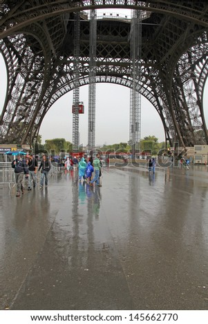 PARIS, FRANCE-OCTOBER, 11:With 7 million visitors in 2011, the Eiffel Tower is also the most visited paid monument in the world on October 11, 2012 in Paris. - stock photo