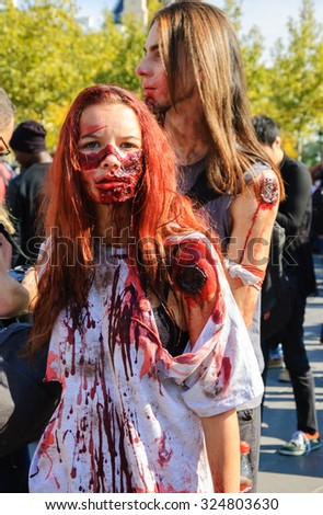PARIS, FRANCE - OCTOBER 3, 2015: Young couple in zombie costume participating in Zombie parade at Place de la Republique. Zombie Walk is an annual event in Paris - stock photo
