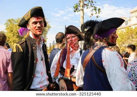PARIS, FRANCE - OCTOBER 3, 2015: Young people in costumes of  zombie pirates participating in Zombie parade at Place de la Republique. Zombie Walk is an annual event in Paris. - stock photo