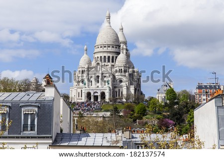 Paris, France, on April 29, 2013. View of Montmartre and cathedral Sakre-Ker from a house window in the sunny spring afternoon - stock photo