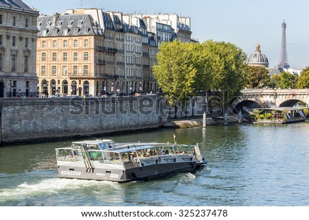 PARIS, FRANCE, on AUGUST 29, 2015. Skyline on Seine Embankment. The walking ship floats down the river