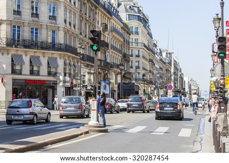 PARIS, FRANCE, on AUGUST 26, 2015. Typical city street in the summer solar morning