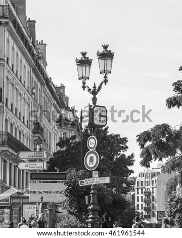 PARIS, FRANCE, on JULY 7, 2016. A beautiful streetlight against architecture