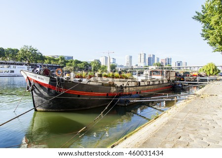 PARIS, FRANCE, on JULY 7, 2016. Urban view. Barges are moored at the coast of Seine
