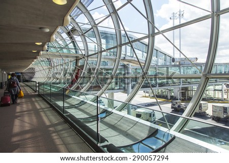 PARIS, FRANCE - on MAY 5, 2015. The international airport Charles de Gaulle, gallery with a panoramic glazing, pass to the hall of an arrival