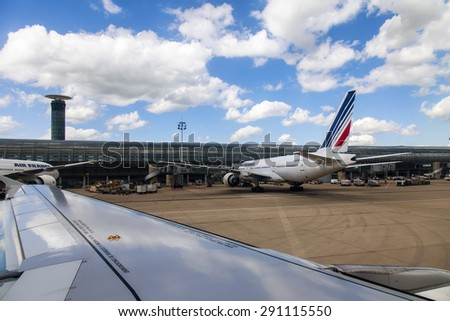PARIS, FRANCE - on MAY 5, 2015. The international airport Charles de Gaulle, service of the plane about the terminal E. A view from the window of the flying-up plane