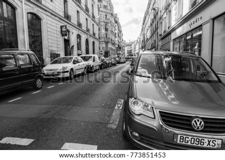 PARIS, FRANCE, on October 30, 2017. Autumn city landscape. Stylish beautiful houses make an attractive architectural complex. Numerous cars are parked near the sidewalk