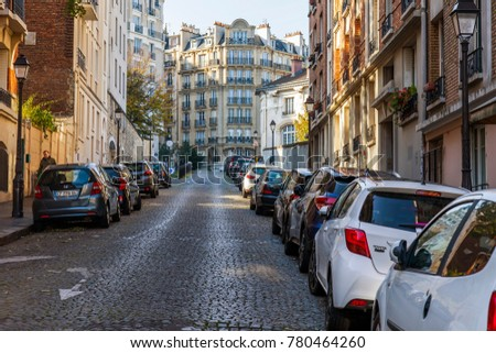 PARIS, FRANCE, on October 30, 2017. Autumn city landscape. Stylish beautiful houses make an attractive architectural complex of the street at the bottom of Montmartre.
