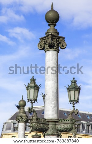 PARIS, FRANCE, on October 27, 2017. The beautiful old lamp with a rich decor decorates the city street of in downtown.