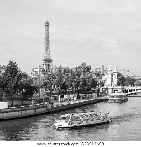 PARIS, FRANCE, on SEPTEMBER 29, 2015. A city landscape with the Eiffel Tower. View of Seine and Alexander III Bridge