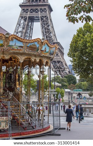 PARIS, FRANCE, on SEPTEMBER 1, 2015. A roundabout near the Eiffel Tower. The Eiffel Tower is one of the most visited and recognizable sights of the world - stock photo