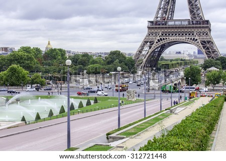 PARIS, FRANCE, on SEPTEMBER 1, 2015. View of the Eiffel Tower and Iena Bridge. The Eiffel Tower is one of the most visited and recognizable sights of the world - stock photo