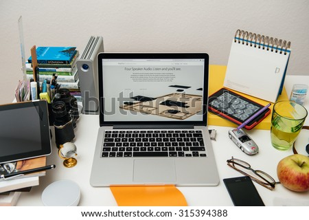 PARIS, FRANCE - SEP 10, 2015: Apple Computers website on MacBook Pro Retina in a creative room environment showcasing the newly announced iPAd pro with four speakers - stock photo