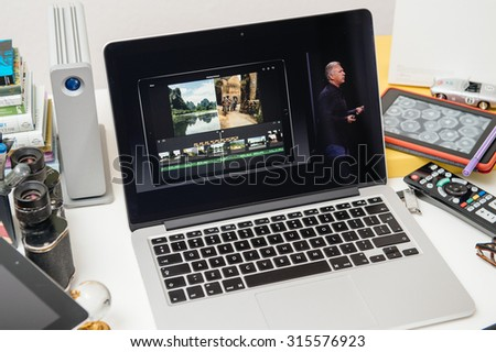 PARIS, FRANCE - SEP 10, 2015: Apple Computers website on MacBook Pro Retina in a creative room environment showcasing Philip Schiller from Apple talking about multitasking of iPad Pro