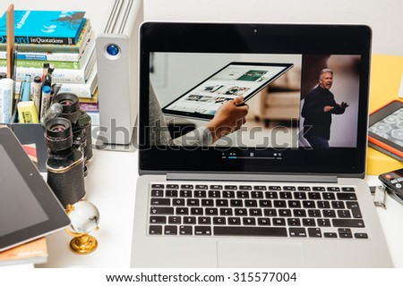 PARIS, FRANCE - SEP 10, 2015: Apple Computers website on MacBook Pro Retina in a creative room environment showcasing Philip Schiller from Apple talking about the iPad Pro