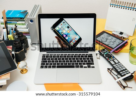 PARIS, FRANCE - SEP 10, 2015: Apple Computers website on MacBook Pro Retina in a creative room environment showcasing the newly announced iPhone 6S - stock photo