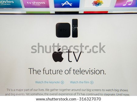 PARIS, FRANCE - SEP 10, 2015: Apple Computers website on MacBook Pro Retina in a creative room environment showcasing the newly announced Apple TV, the future of television - stock photo
