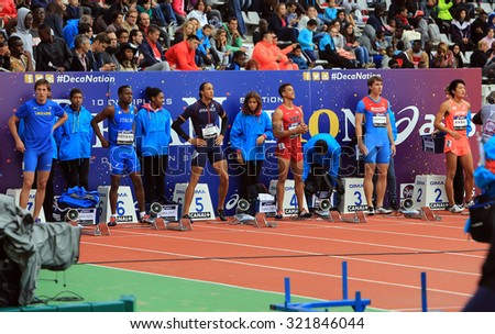 PARIS, FRANCE - SEP.13: Athletes on the start of the 110 hurdles race on DecaNation International Outdoor Games on September 13, 2015 in Paris, France.