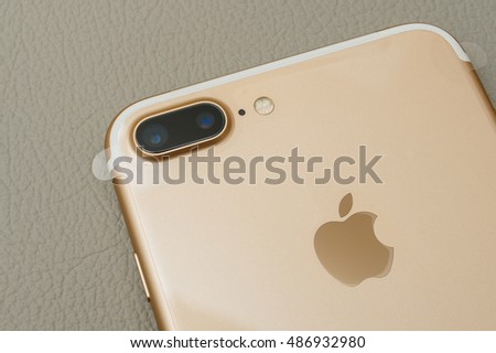PARIS, FRANCE - SEP 16 2016: New Apple iPhone 7 Plus unboxing in the first day of sales - two camera lens and plastic film on phone. New Apple iPhone acclaims to become the most popular smart phone