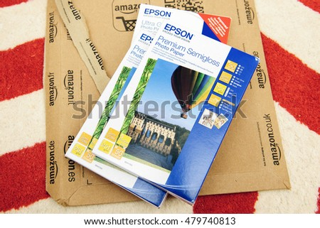 PARIS, FRANCE - SEP 4, 2015: Stack of diverse Epson Premium Semigloss Paper and Ultra Glossy paper on Amazon box - right after unboxing