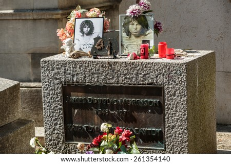 PARIS, FRANCE - SEPT 12, 2014:Jim Morrison grave in Pere-Lachaise cemetery, Paris. Each year thousands fans and curious visitors come to pay homage to Jim Morrison's grave - stock photo