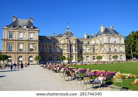 PARIS, FRANCE - SEPT 12, 2014: People enjoy sunny day in the Luxembourg Garden in Paris. Luxembourg Palace is the official residence of  the French Senate.  - stock photo