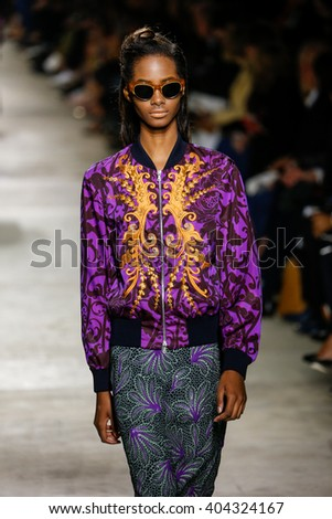PARIS, FRANCE - SEPTEMBER 30: A model walks the runway during the Dries Van Noten show as part of the Paris Fashion Week Womenswear Spring/Summer 2016 on September 30, 2015 in Paris, France.