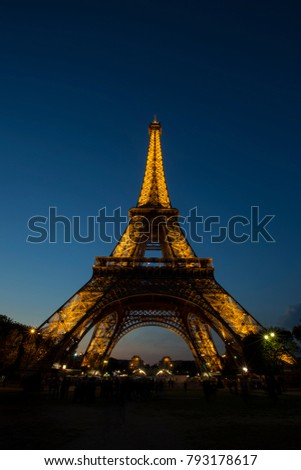 PARIS, FRANCE- SEPTEMBER 21, 2016: Aerial view of Eiffel Tower with light performance show. Eiffel Tower is the famous landmark of Paris.