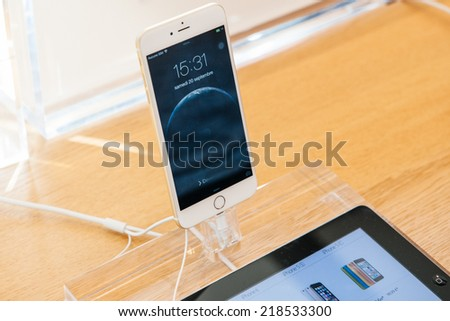 PARIS, FRANCE - SEPTEMBER 20, 2014: Apple Inc. iPhone 6 smartphones stand on display during the sales launch of the latest Apple Inc. iPhone 6 and iPhone 6 Plus devices at the Apple store - stock photo