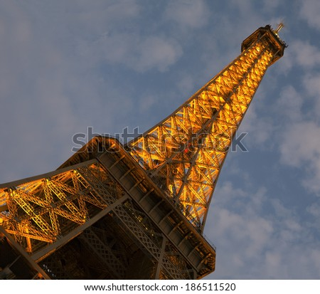 PARIS, FRANCE - SEPTEMBER 10, 2011: Artificially illuminated Eiffel tower during the blue hour after sunset. The Eiffel tower is one of the most visited monuments on the world.  - stock photo