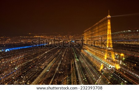 PARIS, FRANCE - SEPTEMBER 10: Blurred unfocused Paris city view at night on September 8, 2014. It was erected in 1889 and has become both a global cultural icon of France and the world. - stock photo