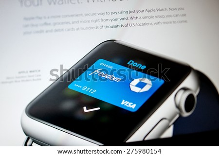 PARIS, FRANCE - SEPTEMBER 10, 2014: Chase Visa Card as seen on a Apple Watch display on the official Apple Store website.  - stock photo