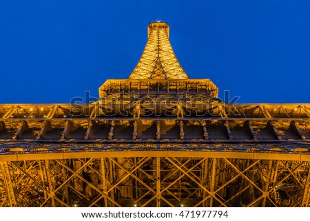 PARIS, FRANCE, SEPTEMBER: Eiffel tower. Closeup detail against the background of evening blue sky.