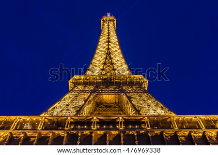 PARIS, FRANCE, SEPTEMBER - 2015: Eiffel Tower Light Beam Show at dusk. Closeup detail against the background of evening blue sky.
