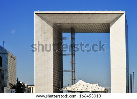 PARIS, FRANCE - SEPTEMBER 24: Grande Arche in district La Defense in Paris, France on September 24, 2013, Europe's largest purpose-built business district visited by 8,000,000 tourists each year.