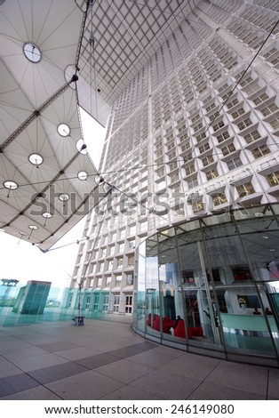 PARIS, FRANCE - SEPTEMBER 21, 2011: Grande Arche in La Defense. La Defense is the largest business district in Europe with 560 ha area, 72 glass and steel buildings and skyscrapers.  - stock photo