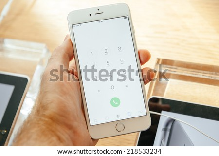 PARIS, FRANCE - SEPTEMBER 20, 2014: Hand holding a iPhone 6 Plus displaying the new dialing buttons during the sales launch of the latest Apple Inc. smartphones at the Apple store in Paris, France - stock photo