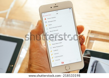 PARIS, FRANCE - SEPTEMBER 20, 2014: Hand holding a iPhone 6 Plus displaying the new Health App details during the sales launch of the latest Apple Inc. smartphones at the Apple store in Paris, France - stock photo
