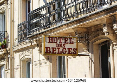 PARIS, FRANCE - SEPTEMBER 10, 2015: Hotel des belges building, sign and front view