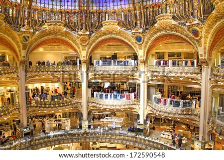 PARIS, FRANCE - SEPTEMBER 4 : inside part of the famous Galeries Lafayette with it's brand stands Hermes, Chanel and Givenchy on September 4th 2013 in Paris, France - stock photo